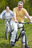 Mature bicyclist — Stock Photo