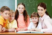 Classmates and teacher — Stock Photo