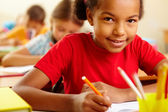 Schoolchild at drawing lesson — Stock Photo