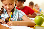 Girl at lesson — Stock Photo