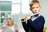 Young flute player — Stock Photo