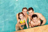 Family in water — Stock Photo