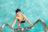 Boy in pool — Stock Photo