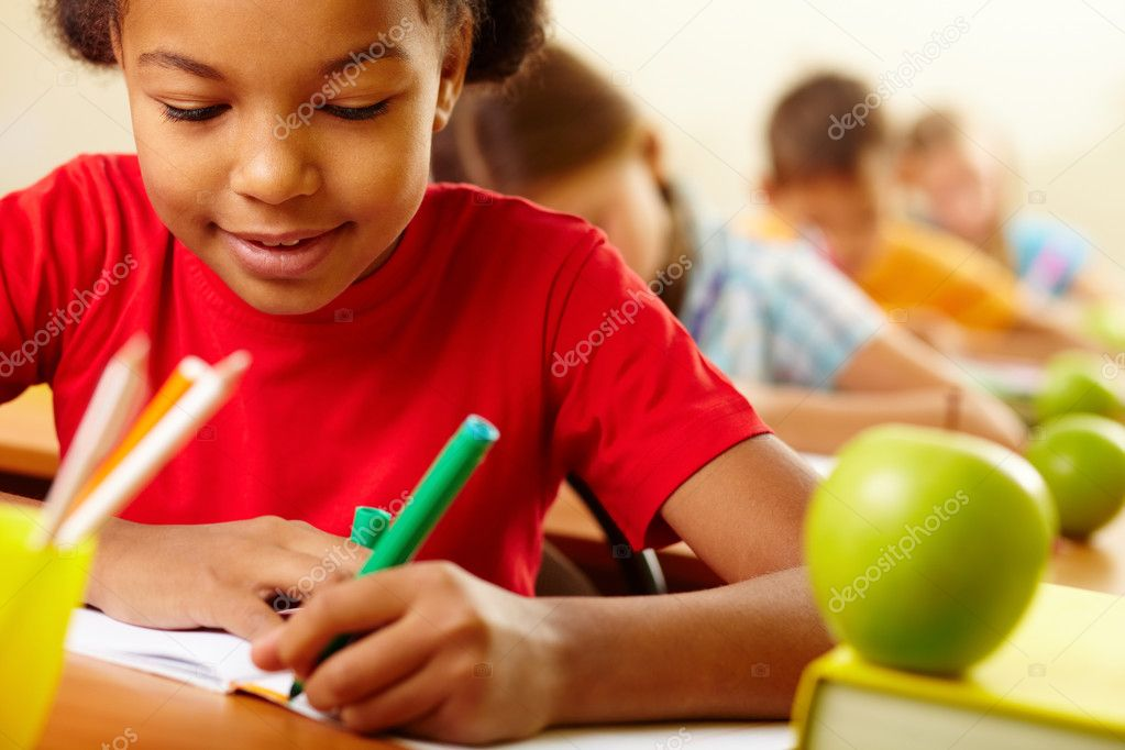 Portrait of lovely girl drawing with crayons at lesson — Stock Photo #11634597