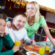 Family in cafe — Stock Photo #11661530