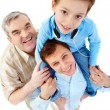 A boy sitting on his father's shoulders — Stock Photo