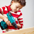 Boy drilling - Stock Photo