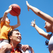 Stock Photo: Playing basketball
