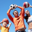 Family playing with balls — Stock Photo #11662180