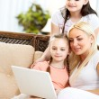 Family with computer - Stock Photo