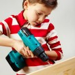 Stock Photo: Boy drilling