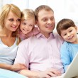 Family with laptop — Stock Photo #11662407