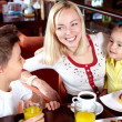 Family in cafe — Stock Photo #11662525