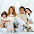 Family on sofa — Stock Photo #11662757
