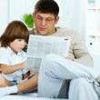 Reading paper together - Stock Photo