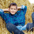 Boy on hay - Foto Stock