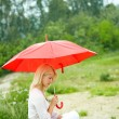 Girl under umbrella — Stock Photo #11663056