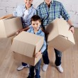 Family with boxes — Stock Photo #11663489