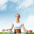 Stock Photo: Meditating girl