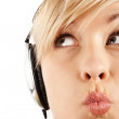 Close-up of a careful girl's face in headphones — Stock Photo