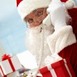 Santa Claus phoning - Stock Photo