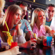 Friends in the bar — Stock Photo