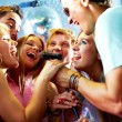 Singing friends — Stock Photo