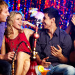 Friends in hookah room — Stock Photo #11666188