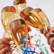 Clinking champagnes — Stock Photo