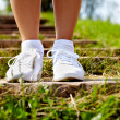 Stock Photo: Feet in sportshoes