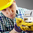 Constructor with house model — Stock Photo