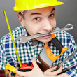 Stock Photo: Repairman with tools