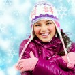 Smiling girl in winter - Stok fotoraf