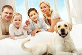 Family and pet — Stock Photo