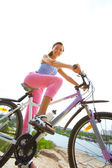 Woman cyclist — Stock Photo