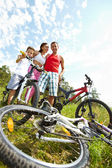 Family with bikes — Stock Photo