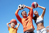 Family playing with balls — Stock Photo