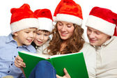 Reading Santas — Stock Photo