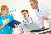 Photo of aged physician and young clinician — Stock Photo