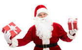 Santa with giftboxes — Stock Photo