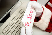 Close-up of Santa hands holding letter — Foto Stock