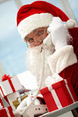 Santa Claus phoning — Stock Photo