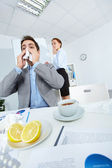 Sneezing in office — Stock Photo