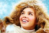 Happy girl in furry hood — Stock Photo
