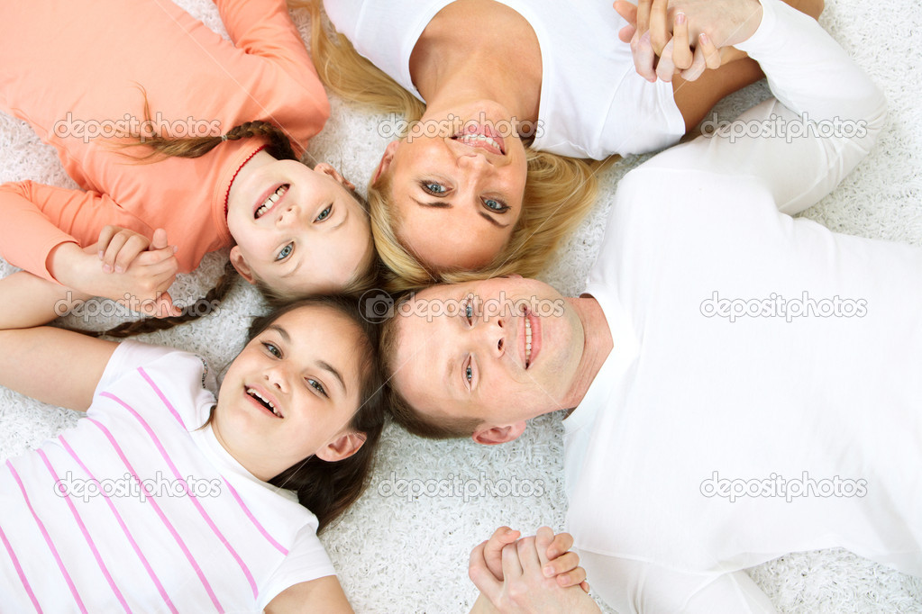 Portrait of cheerful family in casual clothes looking at camera  Stock Photo #11662227