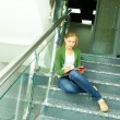 Student on stairs — Stock Photo #11670115