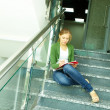 Student on stairs - Stock Photo