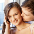 Royalty-Free Stock Photo: Close-up of young man kissing in woman&#039;s neck