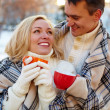 Couple with cups — Stock Photo