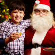 Boy and Santa — Stockfoto